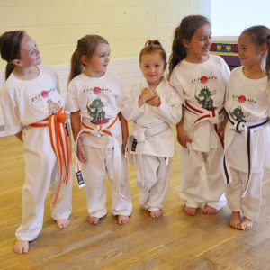 Family of girls come to Karate to practice their moves and have a great time